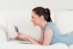 Attractive woman making an online payment Royalty Free Stock Image