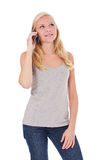 Attractive woman making phone call. Attractive young woman making a phone call. All on white background Stock Photography