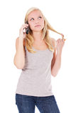 Attractive woman making phone call. Attractive young woman making a phone call. All on white background Stock Photo