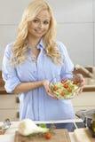 Attractive woman making salad Stock Image