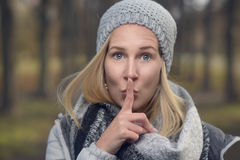 Attractive woman making a shushing gesture Royalty Free Stock Image