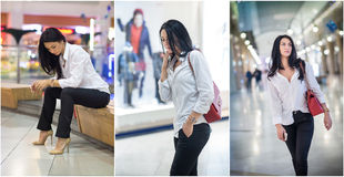 Attractive woman with male white shirt and trousers posing in mall. Beautiful fashionable young girl sitting on bench. In modern shopping center. Long hair Royalty Free Stock Image