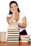 Attractive woman with many books Stock Photography