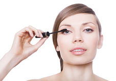 Attractive woman with mascara brush. On white background Stock Photography