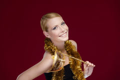 Attractive woman with masquerade mask and tinsel royalty free stock image