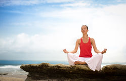 Attractive woman meditating on beach Royalty Free Stock Photo