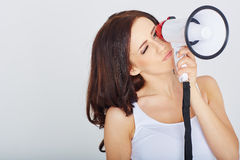 Attractive woman with megaphone Royalty Free Stock Photography