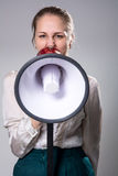 Attractive woman with megaphone Royalty Free Stock Photos