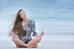 Attractive woman meidtating on sea background Royalty Free Stock Photography