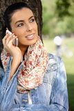 Attractive woman on mobile in park Stock Photography