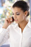Attractive woman on mobile phone Royalty Free Stock Images
