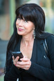 Attractive Woman with Mobile Phone royalty free stock photography