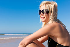 Attractive Woman in monokini on beach Stock Photography