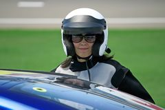 Attractive woman in motoracer uniform Royalty Free Stock Images
