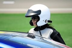 Attractive woman in motoracer uniform Royalty Free Stock Image