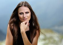 Attractive woman on a mountain landscape Royalty Free Stock Images