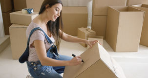 Attractive woman moving house and packing Stock Photography