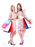 Attractive woman with multicolor shopping bags. Royalty Free Stock Image