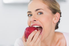 Attractive woman munching apple Stock Photos