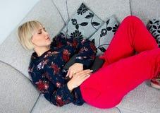 Attractive woman napping at the sofa Stock Photo