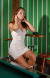 Attractive woman near the billiard-table Royalty Free Stock Image