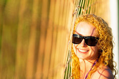 Attractive woman near volleyball net Stock Photos