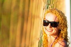 Attractive woman near volleyball net Stock Photos