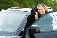 Attractive woman in the new car Stock Photos