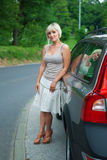 Attractive woman next to car Royalty Free Stock Images