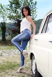 Attractive woman next to car Royalty Free Stock Photos