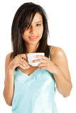 Attractive woman in nightwear drinking from cup Stock Photo