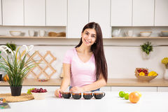 Attractive woman offering tea Stock Images