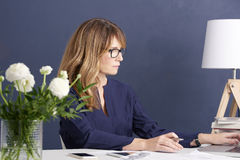 Attractive woman in the office stock image