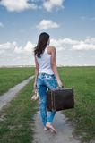 Attractive woman with old suitcase goes afar Stock Photos