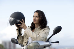 Attractive Woman On A Scooter Stock Photos
