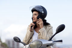 Attractive Woman On A Scooter Royalty Free Stock Images