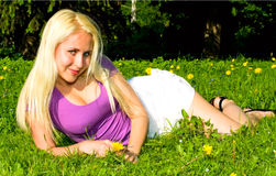 Attractive Woman On The Grass Stock Photo