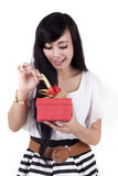 Attractive Woman Open a Gift. Beautiful asian woman opening a christmas gift Royalty Free Stock Photography