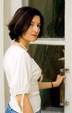 Attractive woman opening the door Stock Photo