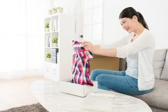 Attractive Woman Opening Parcel Looking Product Royalty Free Stock Images