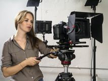 Attractive woman operating a video camera rig royalty free stock photo