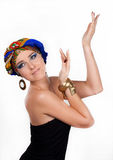 Attractive woman in  oriental turban Stock Images