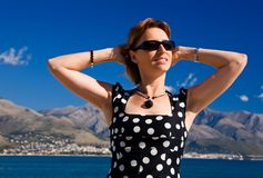 Attractive woman with outstretched arms outdoors. Attractive woman with outstretched arms on the Gaeta sea coast at sunny day Royalty Free Stock Photo