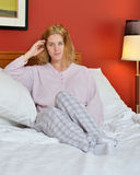 Attractive woman in pajamas in bed Royalty Free Stock Photography