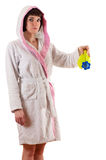 Attractive woman in pajamas with a watering can in hand Stock Photos