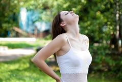 Attractive woman in park Stock Photography
