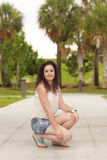 Attractive woman in the park Stock Image
