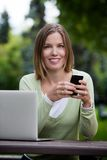Attractive Woman in Park with Smart Phone Stock Photos