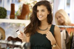 Attractive woman paying by credit card Stock Photo