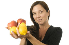 Attractive woman with peaches fresh fruit Stock Images